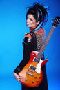 Back of Rock emo girl posing with electric guitar  on bl Royalty Free Stock Photo