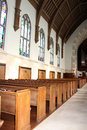 Back of rows of church pews inside the catholic vertical image Stock Images