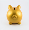 Back side of piggy bank in gold color Royalty Free Stock Photo