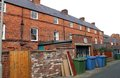 Back of terrace houses rear view terraced house in town with recycling bins Stock Photography