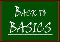 Back to basics the words written on a green board Royalty Free Stock Photos