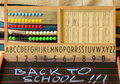 Back to school. Abacus, blackboard, alphabet and numbers