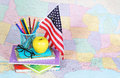Back to school. An apple, colored pencils, American flag Royalty Free Stock Photo
