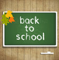 Back to school autumn card with leaves and blackboard Stock Image