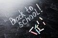 Back to school background on blackboard with chalks.