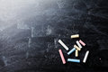 Back to school background on blackboard with colorful chalks.