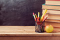 Back to school background with books, pencils and apple Royalty Free Stock Photo
