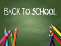 Back to school background with coloured pencils on a chalkboard Royalty Free Stock Images