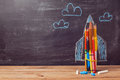 Back to school background with rocket made from coloured pencils Royalty Free Stock Photo