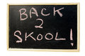 Back to school blackboard sign with an apple and a mm handgun signifying arming teachers Stock Photo