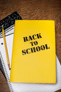 Back to school book with notepad yellow cover a pencil ruled notedpad and compostition on a wood desktop Stock Photography