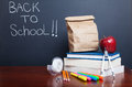Back to school books with apple and paper bag lunch on desk Royalty Free Stock Photo