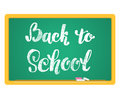 Back to School Chalkboard Background. Hand lettering inscription in chalk on a blackboard. Royalty Free Stock Photo