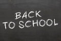 Back to school chalkboard written on black Stock Image