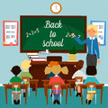 Back to School. Classroom with children. Teacher at the Blackboard Royalty Free Stock Photo