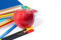 Back to school colored pencils books pen notebooks and an apple Royalty Free Stock Photography