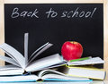 Back to school concept blackboard open books & apple. Royalty Free Stock Photo