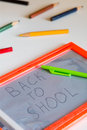 Back to school concept board on table with handwritten text Royalty Free Stock Photos