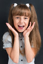 Back to school concept photo of adorable young cheering girl looking at camera at the black background Stock Images