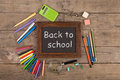 Back to school concept - school supplies on the wooden desk