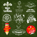 Back to school creative labels in different styles including calligraphic lettering with various stationery set on green Royalty Free Stock Images