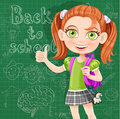 Back to school cute girl at the blackboard on green background Stock Photography
