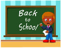 Back to school. Cute schoolchild at the blackboard to answer a lesson