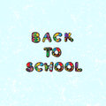 Back to school decorative text with hand drawn letters over a grungy blue backgound Royalty Free Stock Photo