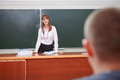 Back to school. Discussion between student and teacher. Royalty Free Stock Photo
