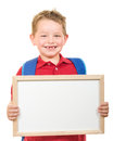 Back to school education concept with child wearing backpack and holding sign Royalty Free Stock Photo