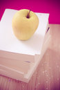 Back to school essentials: books and healthy apple Stock Photo