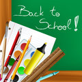 Back to school frame with tools and blackboard in background Royalty Free Stock Image