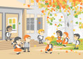 Back to school. Group of happy students walking in the school yard. Autumn day