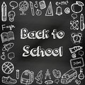Back to school hand drawn doodles on a chalkboard. Education background. Hand drawn school supplies. Vector