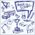 Back to school hand drawn vector illustration set of freehand drawing symbols on a sheet of exercise book Stock Images