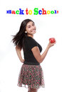 Back to school happy teen girl with apple concept an attractive teenage turning flip her hair while holding and primary color Royalty Free Stock Photography