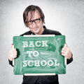 Back to school man holdin green board with latter Stock Images