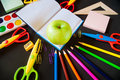 Back to school. Notepad with apple and supplies Royalty Free Stock Photo