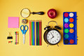 Back to school objects organized on yellow background view from above retro Stock Photo