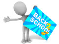Back to school offer on a card held up by a little d man who is very excited with the Royalty Free Stock Photo
