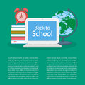 Back to school. Open laptop with text on the screen, pile of books Royalty Free Stock Photo