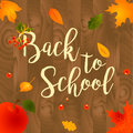 Back to school sale background with leaves, apple and lettering text