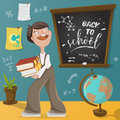 Back to school. Schoolboy, chalkboard and school supplies. Royalty Free Stock Photo