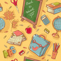 Back to school seamless pattern with various study items in cartoon hand drawn style Stock Photos