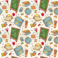 Back to school seamless pattern with various study items in cartoon hand drawn style Royalty Free Stock Photo