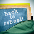 Back to school sentence written in a blackboard with a wooden frame in a schoolbag with a retro effect Royalty Free Stock Photography