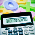 Back to school sentence written in the display of a calculator and numbers of different colors on the background Stock Images