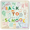 Back to school set of related doodle objects on the lines sheet Royalty Free Stock Photos