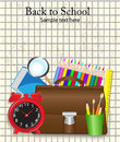 Back to school supplies on the background of shabby sheet in a cage Stock Photography