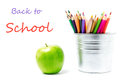 Back to school supplies with color pencils in aluminum pencil h holders or mini bucket on white background closeup Royalty Free Stock Photos